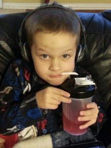 Colin was home sick one day.  Took a pic of him sitting with his tablet, kleenex, and gatorade.  He saw the picture and had to pose.